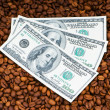 Close up of coffee beans and dollars — Stock Photo #1975260