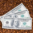 Close up of coffee and dollars — Stock Photo