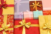 Close up of gift boxes with ribbons — Stock Photo