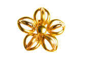 Flower shaped gold earring isolated — Stock Photo