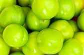 Green apples arranged on the market — Stock Photo