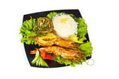 Grilled lobster, rice and vegetables — Stock Photo