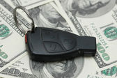 Car remote over the dollar banknotes — Stock Photo