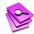 Three books and magnifying glass — Stockfoto