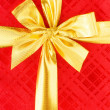 Close up of red gift box with bow — Stock Photo