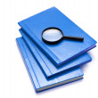 Royalty-Free Stock Photo: Three books and magnifying glass