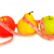 Apples and pear illustrating dieting — Stock Photo