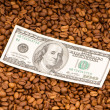Close up of coffee  and dollars - Zdjcie stockowe