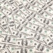 Background with many dollar bills — Stock Photo