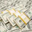 Ten thousand dollar stacks on money — Stockfoto