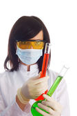 Woman with chemical tubes — Stock Photo
