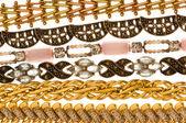 Various bracelets isolated on the white — Stock Photo