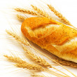 Stock Photo: Bread and wheat ears isolated
