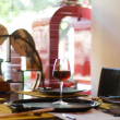 Wine glass on restaraunt table - Stock Photo