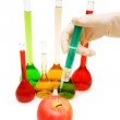 Hand injecting chemical into apple — Stock Photo