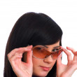 Young girl in sunglasses isolated — Stock Photo