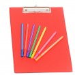 Red pad and colourful pencils isolated — Stock Photo