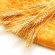 Close up of bread and wheat ears — Stock Photo