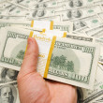 Hand holding american dollars — Stock Photo