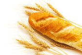 Bread and wheat ears isolated — Stock Photo