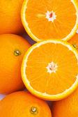 Close up macro shot of half oranges — Stock Photo