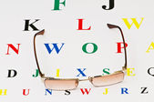 Opical glasses over the eye test table — Stock Photo