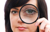 Eye magnified through magnified glass — Stock Photo