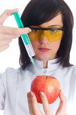 Scientiest injecting chemicals — Stock Photo