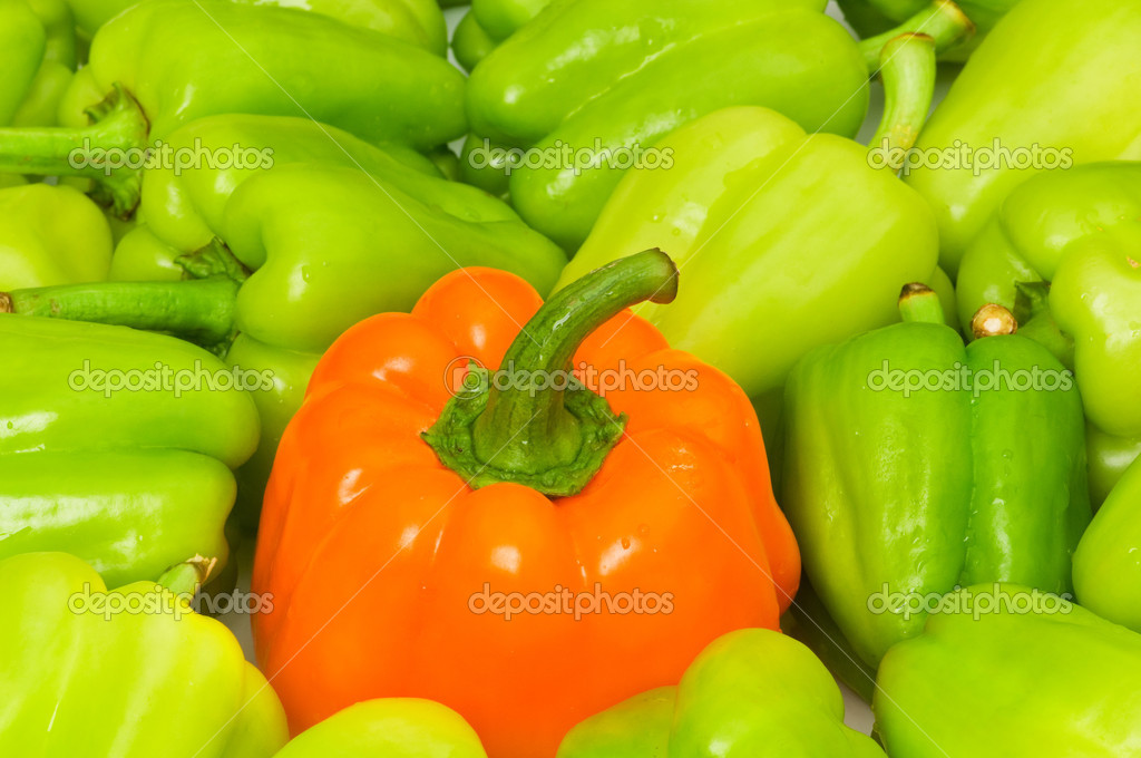 Stand out from crowd concept with green and orange pepper  Stock Photo #2602822