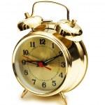 Golden alarm clock isolated — Stock Photo