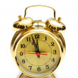 Golden alarm clock isolated — Stock Photo