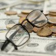 Reading glasses over money — Stock Photo #2633657