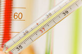 Thermometer and chemical tubes — Stock Photo