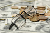 Reading glasses over money — Stock Photo