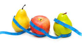 Pears and apple illustrating dieting — Stock Photo