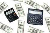 Dollars and calculators isolated — Stock Photo