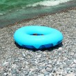 Ring buoy on beach in summer — Stock Photo #2650178