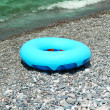 Ring buoy on the beach in summer — Stock Photo #2650178