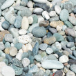 Lots of small pebbles on the beach — Stock Photo