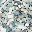 Stock Photo: Lots of small pebbles on the beach