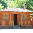 Wooden house on a summer day — Stock Photo