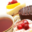 Cup of tea and various fruit cakes — Foto de Stock