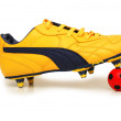 Soccer footwear and color football — Stock Photo