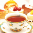 Foto Stock: Cup of tea and various cakes