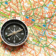 Stock Photo: Compass over the map of UK