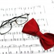 Stock Photo: Bow tie and reading glasses