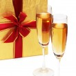 Giftbox and champagne isolated — Stock Photo