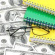 Americdollars, reading glasses — Stock Photo #2652259