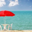 Table, chairs and parasol on the beach — Stock Photo #2652819