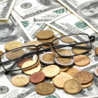 Royalty-Free Stock Photo: American dollars, reading glasses